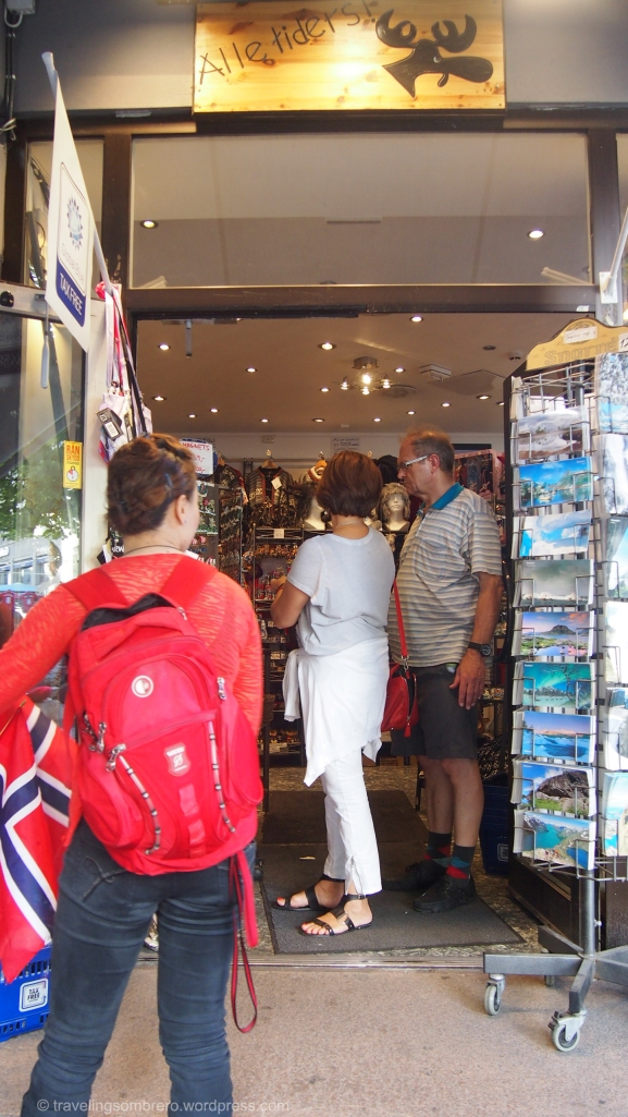 My friend surveying a souvenir shop. We realized later her backpack was open and this is probably the street where she got pickpocketed.